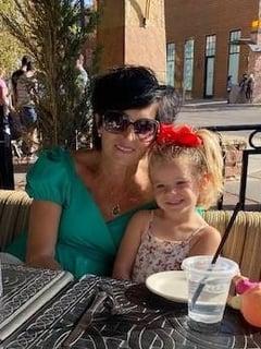 Bladder cancer patient holding her granddaughter