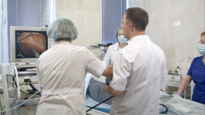 A team of doctors reviewing images from colon cancer screening