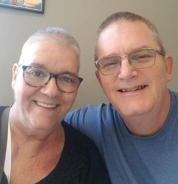 breast cancer survivor and husband get matching hairstyles