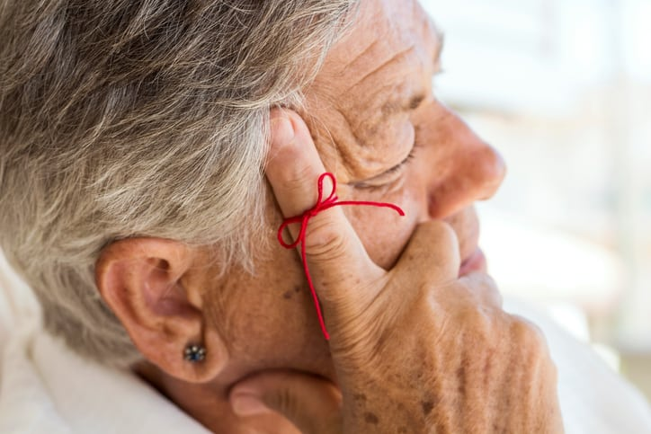 Older person with ribbon on finger chemo side effects memory loss